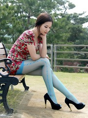 Leggy japanese girl in blue stockings..